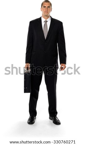 Serious Caucasian man with short medium brown hair in business formal outfit holding briefcase - Isolated