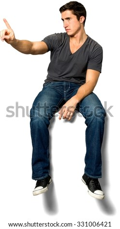 Serious Caucasian young man with short black hair in casual outfit waving finger - Isolated - stock photo
