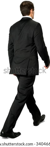 Serious Caucasian young man with short dark brown hair in business formal outfit walking - Isolated - stock photo