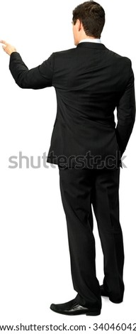 Serious Caucasian young man with short dark brown hair in business formal outfit with hands in pockets - Isolated