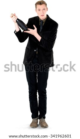 Serious Caucasian young man with short light blond hair in business formal outfit holding champagne bottle - Isolated