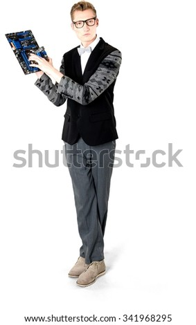 Serious Caucasian young man with short light blond hair in evening outfit holding computer hardware - Isolated