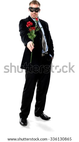 Serious Caucasian young man with short medium brown hair in business formal outfit giving flower - Isolated