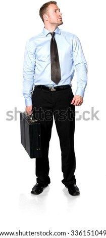 Serious Caucasian young man with short medium brown hair in business formal outfit holding briefcase - Isolated