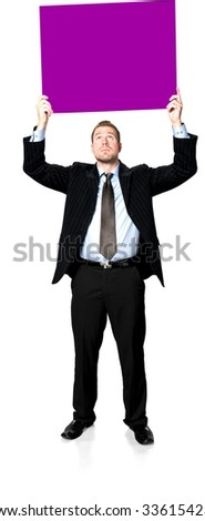 Serious Caucasian young man with short medium brown hair in business formal outfit holding large sign - Isolated - stock photo