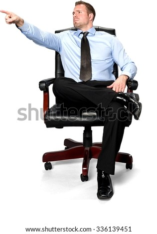 Serious Caucasian young man with short medium brown hair in business formal outfit pointing using finger - Isolated