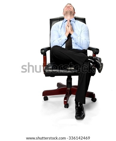 Serious Caucasian young man with short medium brown hair in business formal outfit praying - Isolated