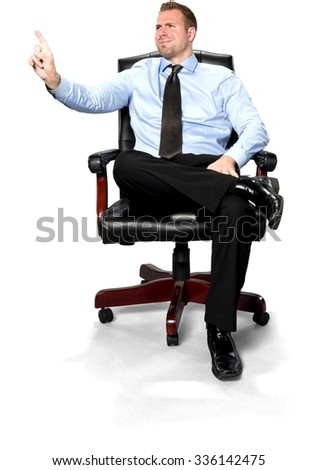 Serious Caucasian young man with short medium brown hair in business formal outfit with hands on thighs - Isolated