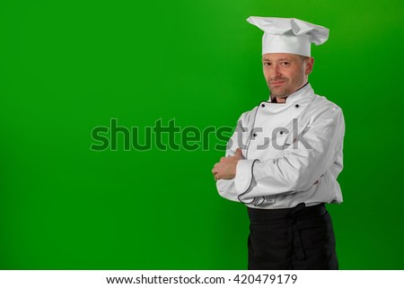 serious chef standing with his arms crossed