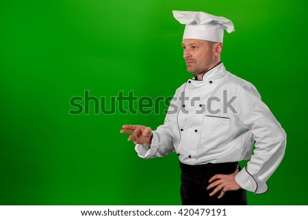 serious chef standing with his arms crossed - stock photo