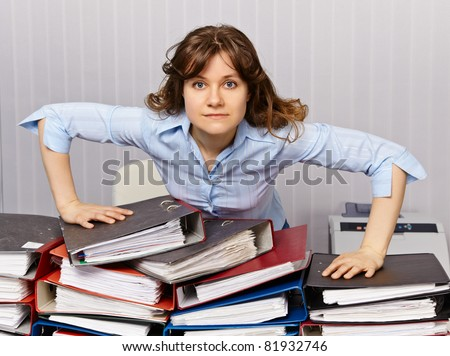 Serious chief accountant at the workplace with the documentation - stock photo