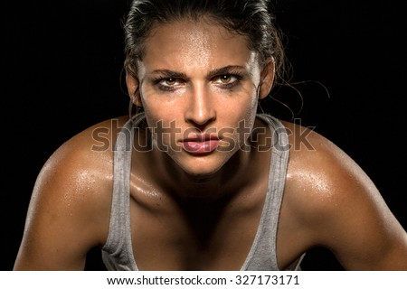 Serious confident stare champion athlete wrestler exercise trainer conviction focused powerful modern female - stock photo