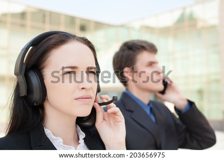 Serious customer support operators with smiling