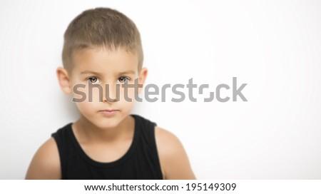 Serious cute little boy portrait  - stock photo