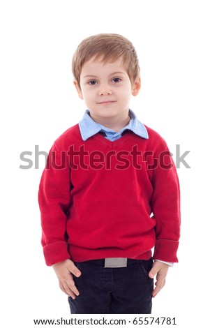 Serious cute little boy stands isolated on white background