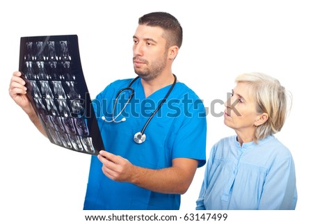 Serious doctor man showing results of magnetic resonance imaginig to a senior patient and both being worried isolated on white background