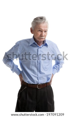 serious elderly man posing on white background