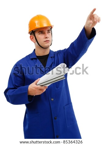Serious engineer with yellow helmet, holding rolls of projects, pointing upwards - stock photo
