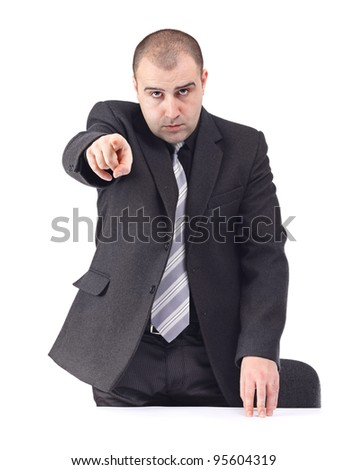 Serious expression of an adult business man pointing to someone.White background - stock photo