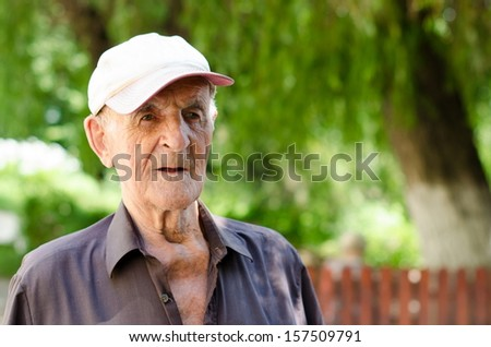 Serious expression 90 year old elder senior man - stock photo