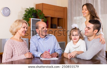 Serious family members ready to sign banking documents - stock photo