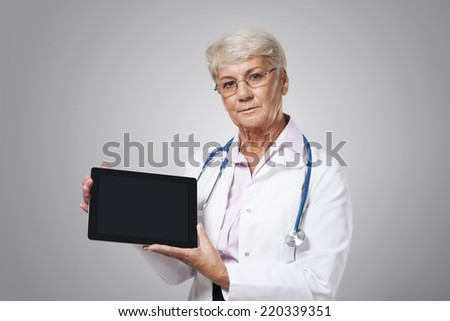 Serious female doctor with bad news