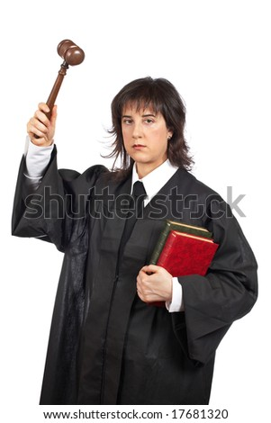 Serious female judge holding the gavel and books. Shallow depth of field - stock photo