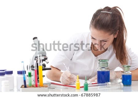 Serious female scientist writing on her clipboard