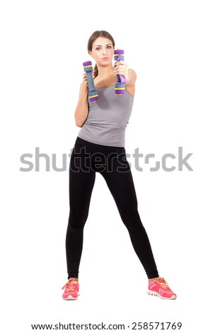 Serious fitness beauty boxing with dumbbells. Full body length portrait isolated over white background.
