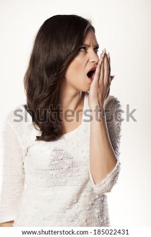 serious girl checks her mouth breath - stock photo