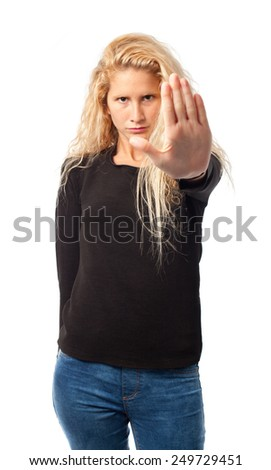 Serious girl with stop gesture - stock photo