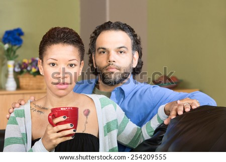 Serious handsome man with beautiful woman holding hands - stock photo