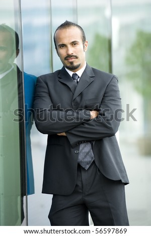 Serious Hispanic business man - stock photo