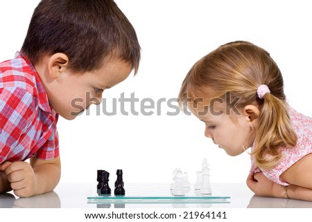Serious kids playing chess - isolated - stock photo