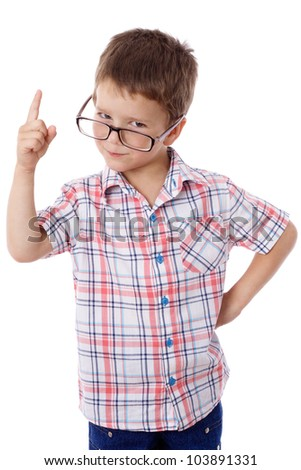 Serious little boy in glasses with empty pointing hand, isolated on white - stock photo