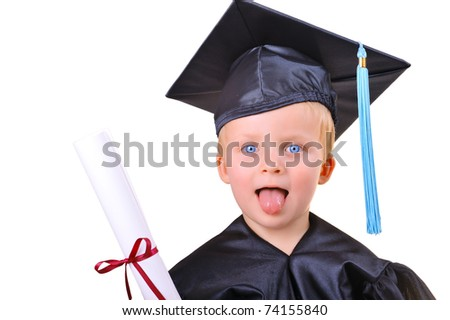 Serious little boy in graduation dress receiving his first diploma - stock photo