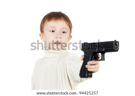 serious little boy with the big black pistol - stock photo
