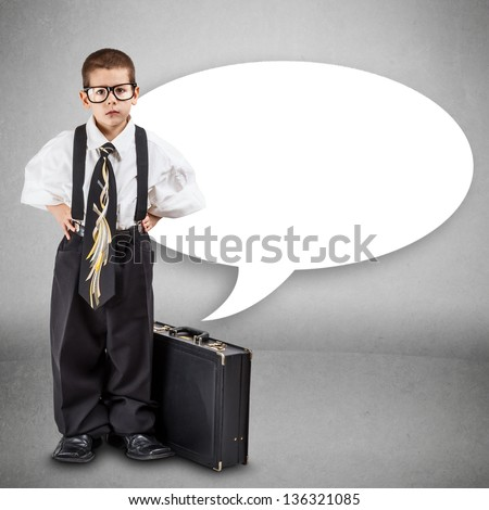 Serious little business boy with office briefcase - stock photo