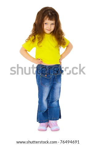 Serious little girl in jeans isolated on white background - stock photo