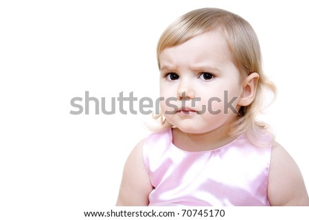 Serious little girl isolated on white background 16-22 months
