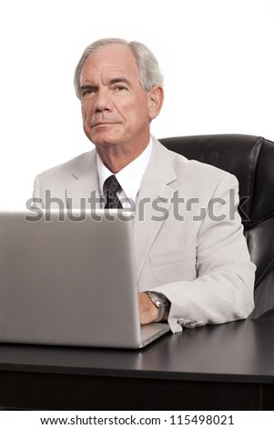 Serious Looking Businessman with laptop - stock photo