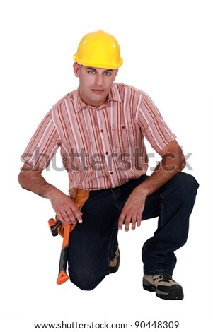 Serious looking construction worker - stock photo