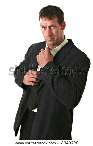 Serious Looking Man Fixing the Tie on Isolated Background - stock photo