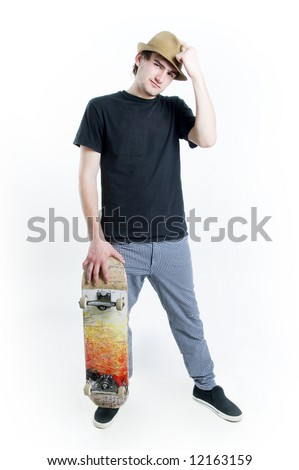 Serious looking teenager with skate isolated on white background - stock photo
