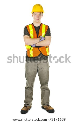 Serious male construction worker in safety vest and hard hat - stock photo
