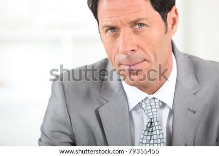 Serious male executive - stock photo