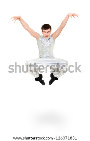 serious man dancer jumping on a white background - stock photo