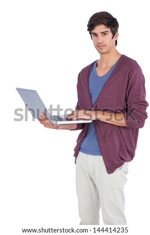 Serious man holding a laptop on a white background