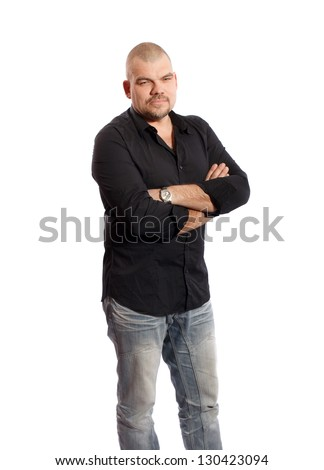 serious man in black shirt standing on white background