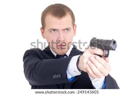 serious man in business suit shooting with gun isolated on white background - stock photo